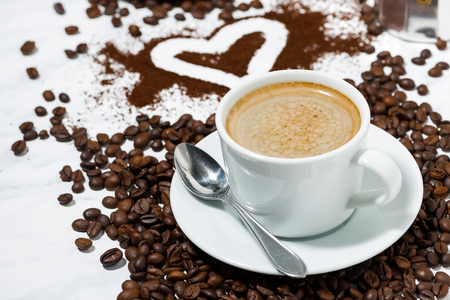 Cup of espresso, heart and coffee beans