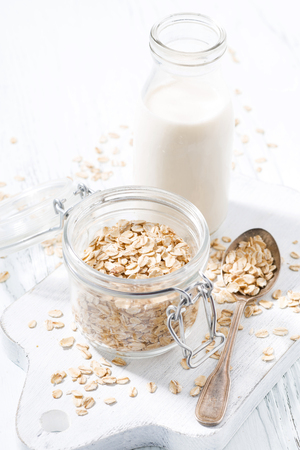 Oat flakes and bottle of milk Stock Photo