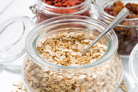 Oat flakes and dried berries for breakfast, closeup, horizontal