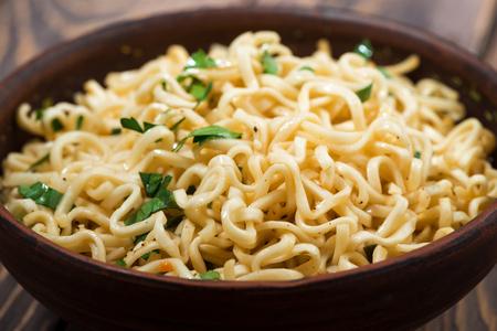 Bowl of traditional Chinese noodles, closeup horizontal Reklamní fotografie