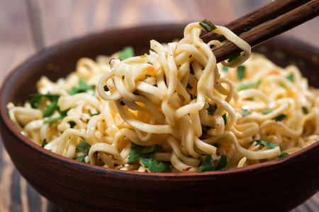 Traditional Chinese noodles and chopsticks, closeup Stock Photo