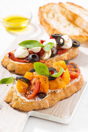 Italian appetizer - bruschetta on wooden board Stock Photo
