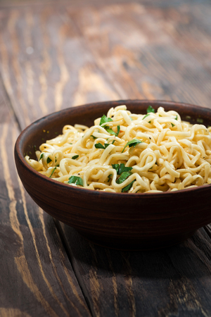 Bowl of traditional Chinese noodles Stock Photo