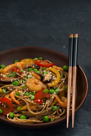 Buckwheat noodles with seafood , closeup vertical, top view
