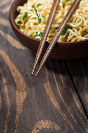 Traditional Chinese noodles and chopsticks, selective focus Stock Photo