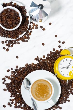 Espresso cup and alarm clock, conceptual photography, top view