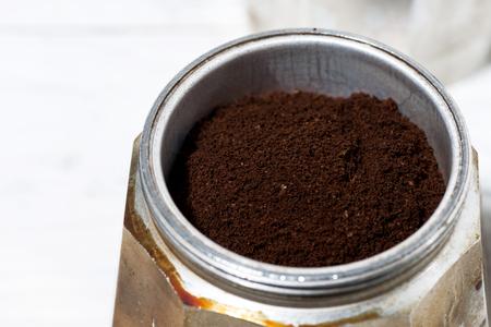 Ground coffee in a geyser coffee machine, closeup top view Reklamní fotografie