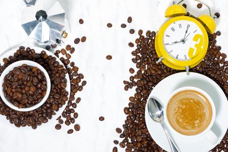 Espresso cup and alarm clock, conceptual photography, top view horizontal