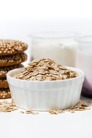 Oatmeal cookies and fruit yogurt, vertical closeup