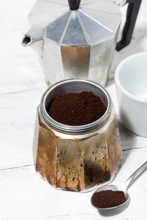 Ground coffee in a geyser coffee machine, vertical top view