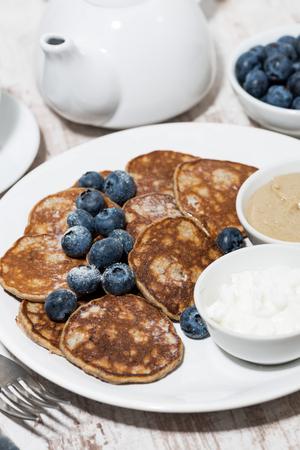 Homemade pancakes with peanut butter and yogurt, vertical top view Reklamní fotografie