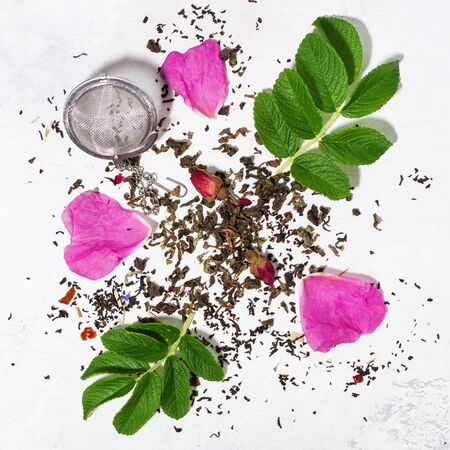 ingredients for making tea with wild rose on a white table, top view Zdjęcie Seryjne