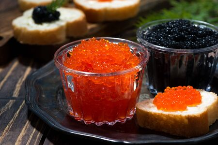 Traditional red and black caviar and sandwiches on plate, closeup Stockfoto