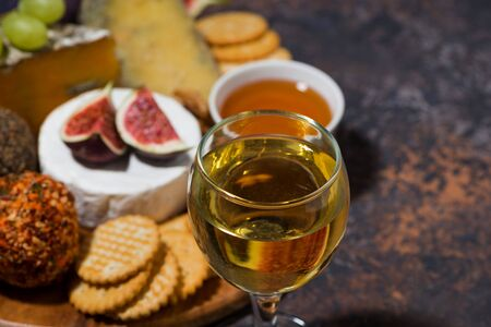 gourmet cheeses with a glass of white wine, closeup 写真素材