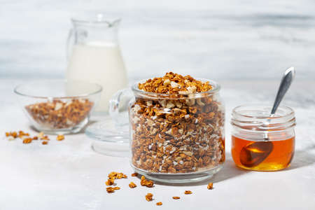 homemade granola with coconut and nuts on white background, horizontal Standard-Bild
