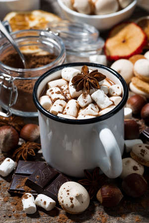 hot chocolate with marshmallows and sweets, vertical closeup Standard-Bild
