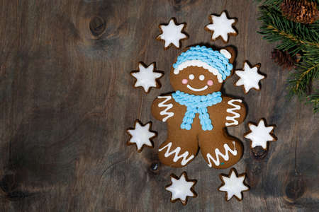 homemade gingerbread man and stars cookies on gray wooden background, closeup top view Standard-Bild