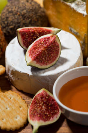 delicious snacks, cheese, crackers and fruits, closeup