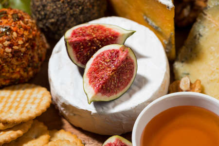 delicious snacks, cheese, crackers and fresh fruits, closeup horizontal Standard-Bild