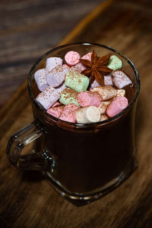 cup of hot chocolate with marshmallows, top view vertical
