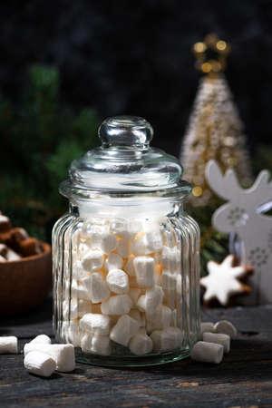 jar with sweet marshmallows and Christmas decorations, closeup Standard-Bild