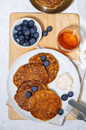 homemade pancakes with blueberries and yogurt for breakfast, vertical