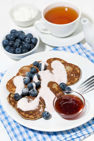 homemade pancakes with blueberries and jam, top view