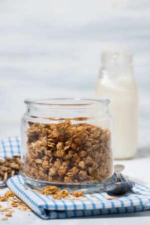 homemade granola and milk - healthy foods, closeup