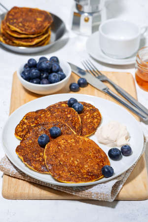 homemade pancakes with blueberries and yogurt, vertical top view