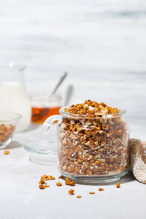 homemade granola with coconut and nuts on white background, closeup Standard-Bild
