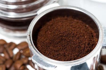 holder with aroma ground coffee on table, closeup horizontal Standard-Bild