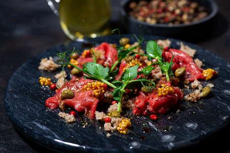 fresh beef carpaccio with capers and arugula, closeup Standard-Bild