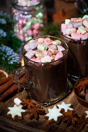 hot chocolate with marshmallows in glass mugs, vertical