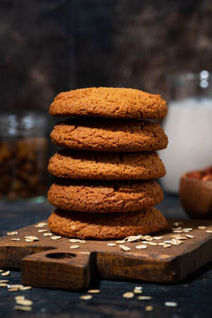 fresh oatmeal cookies and baked goods, vertical closeup