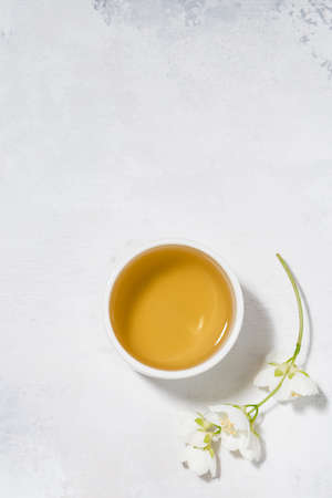 pialat with green tea on a white background and jasmine, top view Stock Photo