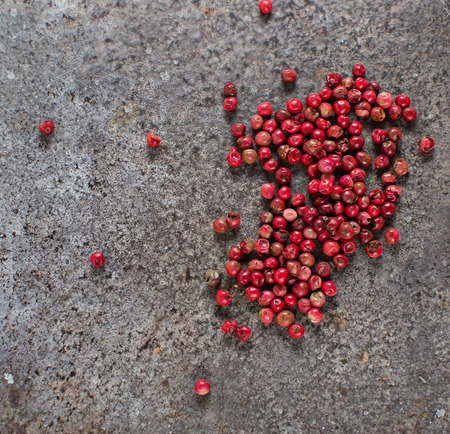 Rose pepper in grunge background Фото со стока