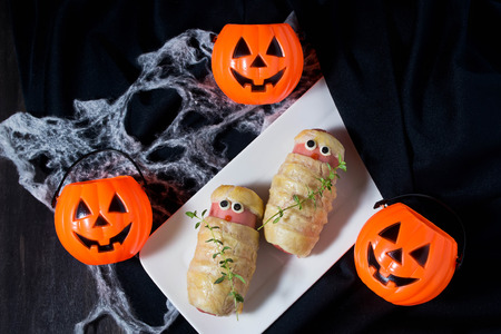 Halloween sausage in the dough decorated to look like mummies