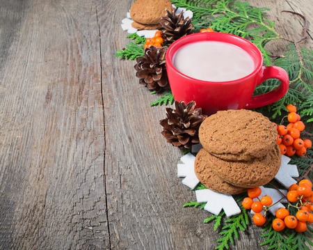 Christmas cookies and hot chocolate with tree, copy space composition photo