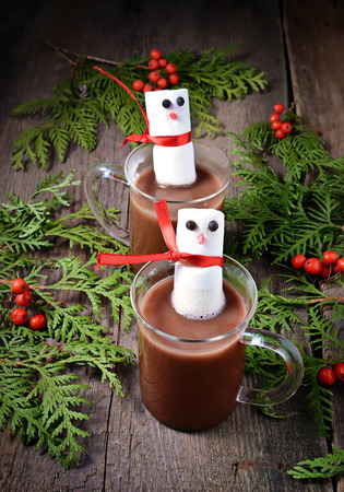 Mug of hot chocolate with marshmallows snowman photo