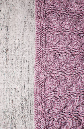 Pink knitted woolen background. Fabric texture photo