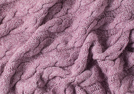 Pink knitted woolen background.  photo
