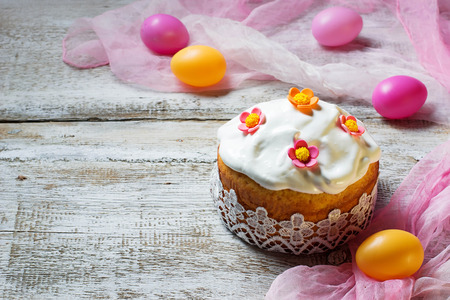 Traditional Easter cake and painted eggs. Selective focus. Space for text photo
