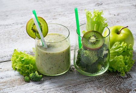 Green fresh smoothie with kiwi, apple, salad and broccoli, healthy drink. Selective focus