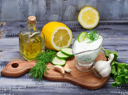 tzatziki: Greek sauce tzatziki and cucumber, mint, dill, garlic, lemon, oil. Selective focus
