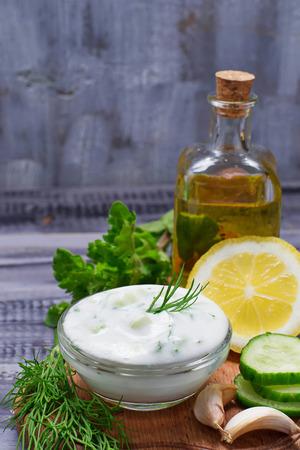 tzatziki: Greek sauce tzatziki and cucumber, mint, dill, garlic, lemon, oil Stock Photo