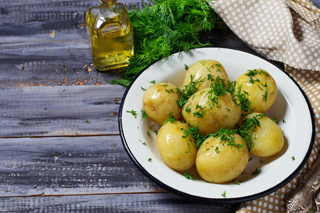 spud: Boiled potatoes with fresh dill Stock Photo