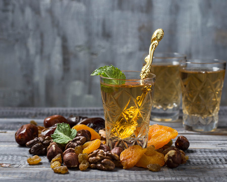 frutas secas: Traditional arabic tea and dry fruits. Selective focus