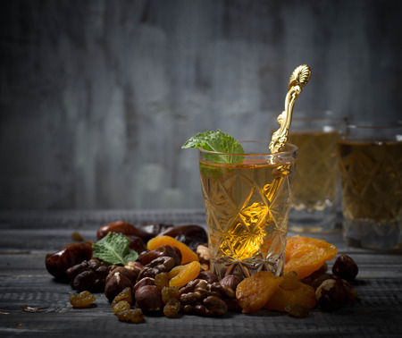 frutas secas: Traditional arabic tea and dry fruits. Selective focus