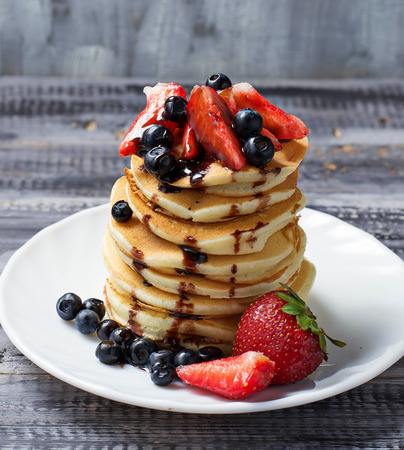 Sweet pancakes with fresh berries. Selective focus
