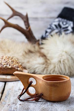 pelage: Tea in traditional finnish cup kuksa. Selective focus